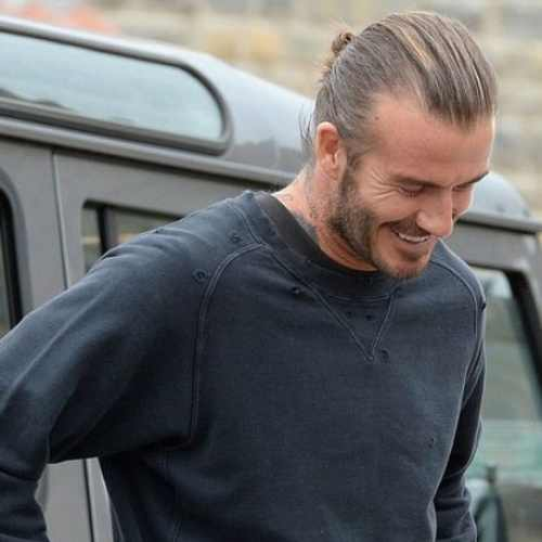 david beckham man bun hairstyle textured hair