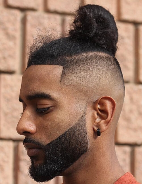 bald fade skin side part haircut with man bun line up beard