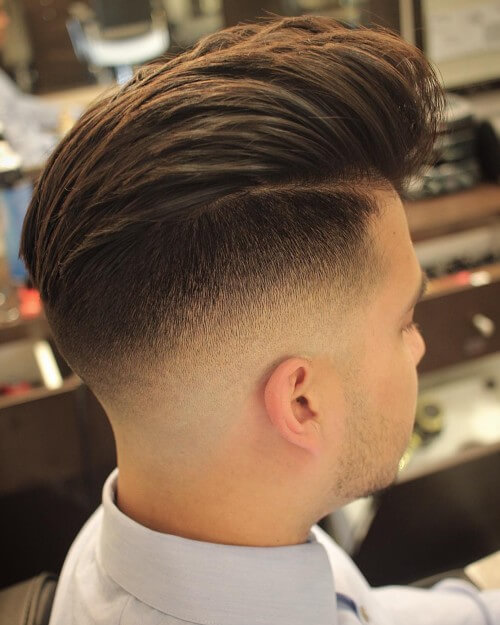 high wavy quiff men hairstyle with high bald fade haircut