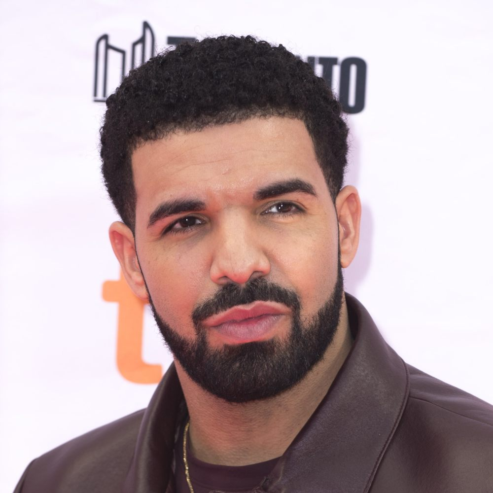 drake short curly haircut mustache style