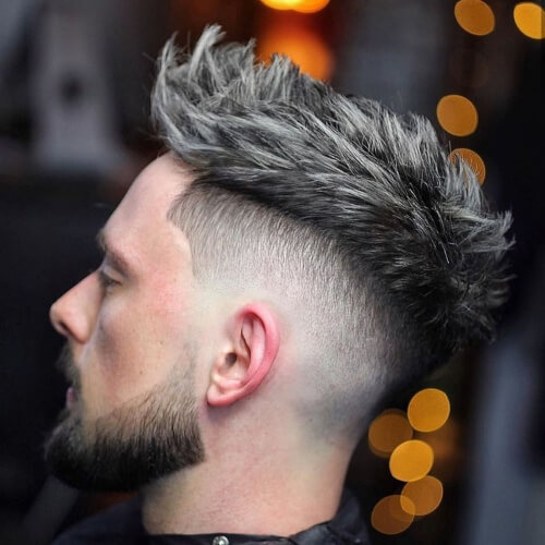 mexican haircut gray messy spikes on top side mid to low fade