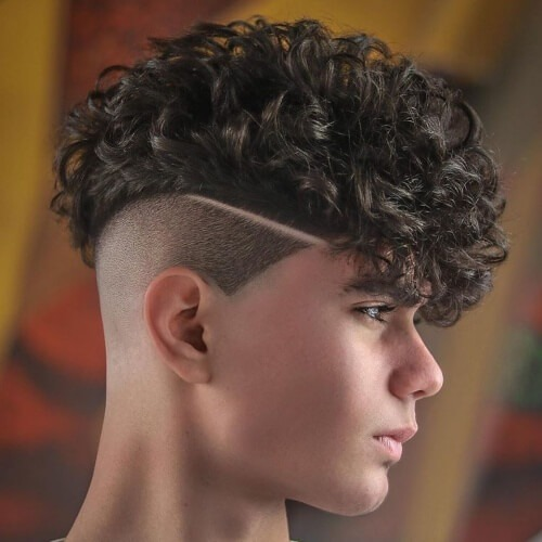 mexican mohawk boys hairstyle with curly hair