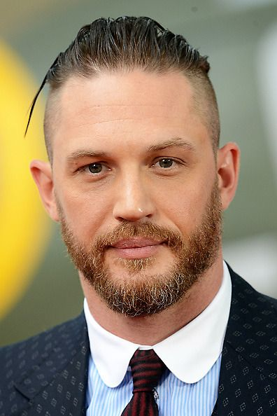 tom hardy medium length slicked back hair side part bald fade