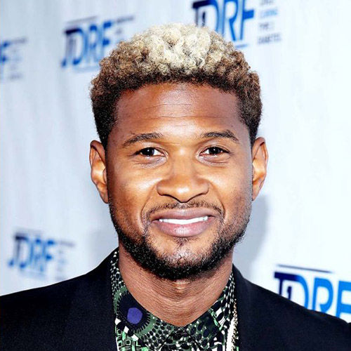 usher colored mohawk curly hair with fade