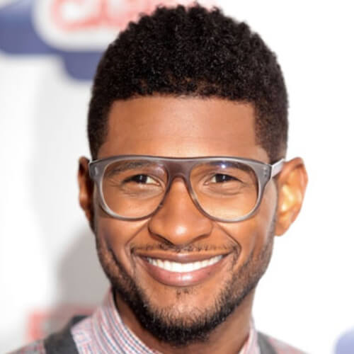 usher new haircut curly